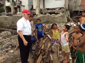 Archbishop Kurtz talks to the children in Tacloban,