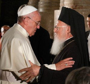 Pope Francis and Ecumenical Patriarch Bartholomew of Constantinople embrace during an ecumenical celebration in the Church of the Holy Sepulcher in Jerusalem May 25. (CNS/Paul Haring)
