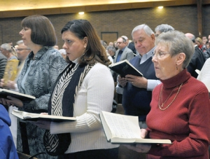 Parishioners of St. Barnabas Church joined in singing at the parish's closing Mass Nov. 22.