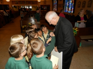 Archbishop Kurtz with students at St. Rita School. St. Rita has increased its overall enrollment as well as its enrollment of Hispanic students over the last two years.